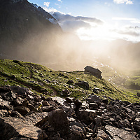 Joey Schusler climbs from the Elisabetta hut, Val Veny, Italy, during filming for Yeti Cycles Photo Vagabond.