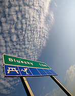 © 2008 Randy Vanderveen, all rights reserved.Grande Prairie, Alberta.A highway sign for the hamlet of Bluesky, Alberta only partly describes the condition of the sky overhead.