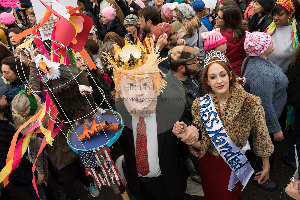 Demonstrators costumed as Donald and Melania Trump during the Women's March on Washington in protest to President Donald Trump January 21, 2017 in Washington, DC. More than 500,000 people crammed the National Mall in a peaceful and festival rally in a rebuke of the new president.
