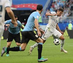SAMARA, June 25, 2018  Roman Zobnin (R) of Russia breaks through with the ball during the 2018 FIFA World Cup Group A match between Uruguay and Russia in Samara, Russia, June 25, 2018. (Credit Image: © Bai Xueqi/Xinhua via ZUMA Wire)