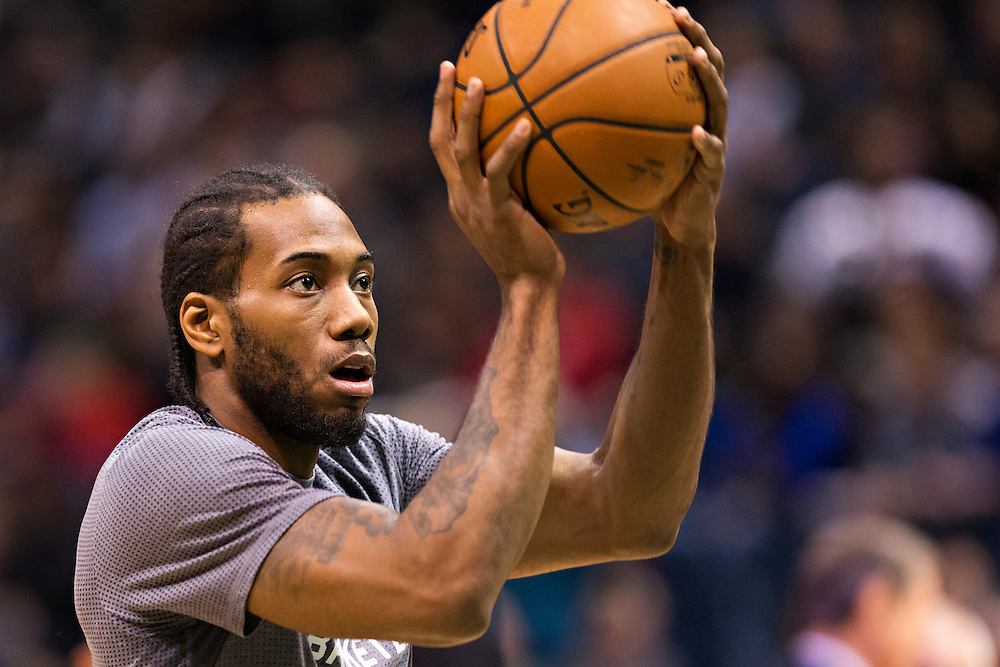 """MILWAUKEE, WI- JANUARY 4:  Kawhi Leonard #2 of the San Antonio Spurs warming up before a game against the Milwaukee Bucks at BMO Harris Bradley Center on January 4, 2016 in Milwaukee, Wisconsin.  """"NOTE TO USER: User expressly acknowledges and agrees that, by downloading and or using this photograph, User is consenting to the terms and conditions of the Getty Images License Agreement.""""(Photo by Wesley Hitt/Getty Images) *** Local Caption *** Kawhi Leonard"""