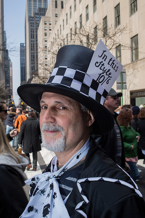 New York, NY, USA-27 March 2016. A man dressed as Lewis Carroll's Mad Hatter, his top hat complete with price tag,  in the annual Easter Bonnet Parade and Festival.