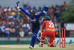 July 8, 2017 - Mahinda, Sri Lanka - Zimbabwe cricketer Solomon Mire(R) is dismissed as  Sri Lanka's wicket keeper Niroshan Dickwella(R) celebrates  during the 4th One Day International cricket matcth between Sri Lanka and Zimbabwe at ..Mahinda Rajapaksa International Cricket Stadium, (southern part of Sri Lanka) at Hambantota, ..Sri Lanka on Saturday 8 th July 2017. (Credit Image: © Tharaka Basnayaka/NurPhoto via ZUMA Press)