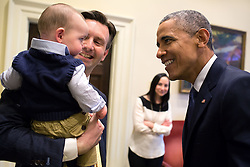 President Barack Obama greets Press Secretary Josh Earnest and his son Walker as Earnest's wife, Natalie Wyeth Earnest looks on in the Outer Oval Office, March 20, 2015. (Official White House Photo by Pete Souza)<br /> <br /> This official White House photograph is being made available only for publication by news organizations and/or for personal use printing by the subject(s) of the photograph. The photograph may not be manipulated in any way and may not be used in commercial or political materials, advertisements, emails, products, promotions that in any way suggests approval or endorsement of the President, the First Family, or the White House.