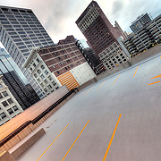 On top of a parking garage on Main Street between 10th and 11th Streets in downtown Kansas City with a view of the nearby skyscrapers.