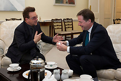 © Licensed to London News Pictures. 11/10/2012. LONDON, UK. U2 singer Bono (R) presents the British Deputy Prime Minister Nick Clegg with an iPod, containing the band's latest album as the pair meet to discuss international development issues in Whitehall, London, today (11/10/12). Photo credit: Matt Cetti-Roberts/LNP