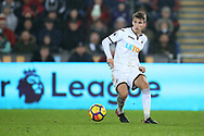Tom Carroll of Swansea city in action. Premier league match, Swansea city v Crystal Palace at the Liberty Stadium in Swansea, South Wales on Saturday 23rd December 2017.<br /> pic by  Andrew Orchard, Andrew Orchard sports photography.