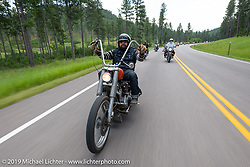 Asian Dan Townsend of Denver on the Cycle Source ride down Vanocker Canyon back from Nemo to the Iron Horst Saloon during the Sturgis Black Hills Motorcycle Rally. SD, USA. Wednesday, August 7, 2019. Photography ©2019 Michael Lichter.