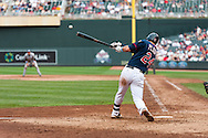 Minnesota Twins 3rd baseman Trevor Plouffe hits a single against the Milwaukee Brewers at Target Field in Minneapolis, Minnesota on June 17, 2012.  The Twins defeated the Brewers 5 to 4 in 15 innings.  The game was the longest in Target Field history.  © 2012 Ben Krause