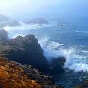 Northern california coast line. Ocean waves crash on shore.