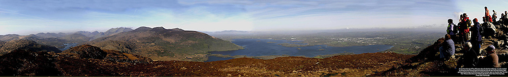 A magnificient panorama view taken on St. Patrick's Day morning from the summit of Torc Mountain, Killarney, overlooking the Upper Lake (on left, the Middle Lake, (centre) and The Lower Lake with walkers taking in the breathtaking view.  Picture by Don MacMonagle