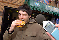 Photo: Leigh Quinnell.<br /> Wycombe Wanderers v Shrewsbury Town. Coca Cola League 2. 11/03/2006. Reporter Nic Brunelti test the noise at the burger bar.