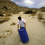 Every year hundreds of migrants die attempting to cross into the United States illegally, the majority from heat stroke and drownings. John Hunter, a self-described humanitarian, spends many weekends with other volunteers placing water stations in remote border regions so migrants don't die of dehydration or heat stroke. The giant barrels are filled with water. Please contact Todd Bigelow directly with your licensing requests. PLEASE CONTACT TODD BIGELOW DIRECTLY WITH YOUR LICENSING REQUEST. THANK YOU!