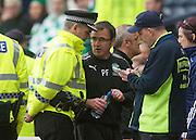 The William Hill Scottish FA Cup Final 2012 Hibernian Football Club v Heart Of Midlothian Football Club..19-05-12...Hibs Manager is escorted away from the technical area by the Strathclyde Police after being sent to the stand        during the William Hill Scottish FA Cup Final 2012 between (SPL) Scottish Premier League clubs Hibernian FC and Heart Of Midlothian FC. It's the first all Edinburgh Final since 1986 which Hearts won 3-1. Hearts bid to win the trophy since their last victory in 2006, and Hibs aim to win the Scottish Cup for the first time since 1902....At The Scottish National Stadium, Hampden Park, Glasgow...Picture Mark Davison/ ProLens PhotoAgency/ PLPA.Saturday 19th May 2012.