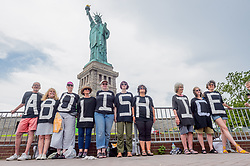 July 4, 2018 - New York, New York, United States - Reflecting the sentiments of last week's nationwide End Family Separation protests, members of Rise and Resist planned and executed a non-violent banner drop and human banner action at the Statue of Liberty on Independence Day. An ABOLISH ICE banner was hung, and activists spelled out the same message on their shirts. (Credit Image: © Erik Mcgregor/Pacific Press via ZUMA Wire)