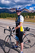 Cyclist on the San Juan Skyway (Highway 145) at Lizard Head Pass, San Juan National Forest, Colorado