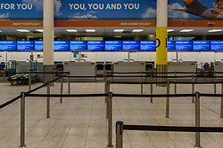 Check-in is deserted as travel company Thomas Cook has ceased trading after failing to come to a deal with its bankers and creditors, leaving tens of thousands of travellers unable to depart on their holidays from South Terminal at Gatwick Airport, and a massive repatriation exercise to return holidaymakers from destinations all over the world. London Gatwick Airport, September 23 2019.