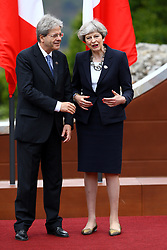 May 26, 2017 - Taormina, Italy - G7 Summit 2017 in Italy..The italian Prime Minister Paolo Gentiloni with the United Kingdom Prime Minister Theresa May during the welcome ceremony and the photo family at Taormina, Italy on May 26, 2017...Leaders of the G7 group of nations, which includes the Unted States, Canada, Japan, the United Kingdom, Germany, France and Italy, as well as the European Union, are meeting at Taormina from May 26-27. (Credit Image: © Matteo Ciambelli/NurPhoto via ZUMA Press)