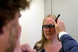 27-06-2014 NED: Uitzwaaimoment Iceland Diabetes Challenge, Nijkerk<br /> In gezondheidscentrum De Nije Veste in Nijkerk werden de Iceland deelnemers en de deelnemers van de Nije Veste challenge uitgezwaaid door gouden olympiër Mark Huizinga, de winnaar van de poolcirkel expeditie 2014 / Bril passen voor Annet