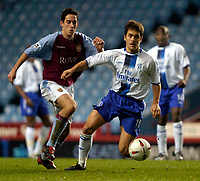 Photo: Richard Lane.<br />Aston Villa v Chelsea. Carling Cup. 17/12/2003.<br />Joe Cole beats Peter Whittingham.