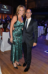 STANLEY TUCCI and his wife FELICITY BLUNT at the GQ Men Of The Year 2014 Awards in association with Hugo Boss held at The Royal Opera House, London on 2nd September 2014.