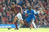 Photo: Henry Browne.<br /> Arsenal v Birmingham City. The Barclays Premiership.<br /> 02/10/2005.<br /> Robert Pires of Arsenal avoids Olivier Tebily of City.