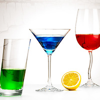 Still life, stylish glass with RGB colors and lemon,