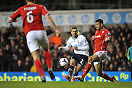 Tottenham's Nacer Chadli curling the ball passed Cardiff's Captain Steven Caulker . Barclays Premier League , Tottenham Hotspur v Cardiff city at White Hart Lane in London, England on Sunday 2nd March 2014.<br /> pic by John Fletcher, Andrew Orchard sports photography.