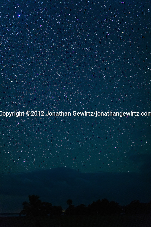 An Orionid meteor trail appears in the star-filled night sky over Florida Bay, as seen from the outdoor amphitheater area in the Flamingo section of Everglades National Park, Florida on October 21, 2012. WATERMARKS WILL NOT APPEAR ON PRINTS OR LICENSED IMAGES.