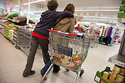 Astrid Holmann and her son Lenard in Hamburg, Germany shopping in the Aldi supermarket. They were photographed for the Hungry Planet: What I Eat project with a week's worth of food in June. Model Released.