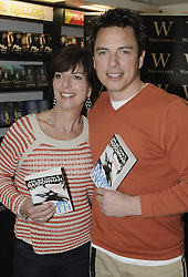 © Licensed to London News Pictures. 04/02/2012. John Barrowman signing his new book, 'Hollow earth', at Waterstones book shop in the  Bluewater shopping complex in Kent Today (04.02.2012). The book is co-authored by his sister (pictured), Carole E. Barrowman, a journalist and professor of English. Photo credit : Grant Falvey/LNP
