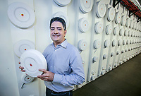 Bruce Miller, VP of Product Marketing for Xirrus, shows off one of their WiFi hotspots in front of a wall of them in the office in Thousand Oaks, CA. Sept. 15, 2015. Photo by David Sprague