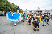 Activists performing the rising seas outside the National Gallery on the first day of the environmental activist group Extinction Rebellion (XR) protest in Trafalgar Square, central London on Monday, Aug 23, 2021. The movement launched a two-week protest campaign to demand that the government take greater action to address climate change. (VX Photo/ Vudi Xhymshiti)