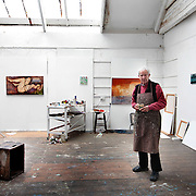 John Emanuel painting in Studio 5.<br /> Originally built to house the wares of pilchard fishermen, artists moved in to the building in the 1890's. For over 100 years the building has remained virtually untouched. The artists still coexist with the fishermen, painting in the lofts above while the fishermen mend their nets and store their fishing gear in the cellars below. Now undergoing much needed renovation, Porthmeor Artist's Studios is a microcosm of St Ives two main industries past and present.