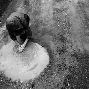On the way to a community lunch, Amanda washes her hands off in a puddle after working in the fields. Many of the farms and plots on which the Young Farmers work were abandoned or unused for many many years, so are lacking basic infrastructure such as electricity or indoor plumbing.