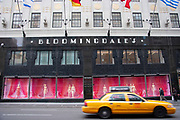 New York Yellow Taxi cab passes famous department store Bloomingdales on 59th Street & Lexington Avenue on 19th May 2007 in New York City, United States.