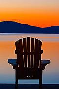 Muskoka chairs on Lake of Bays at dusk<br />near Dorset<br />Ontario<br />Canada