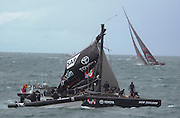 Team New Zealand crew start to stabalise the rig after the disastrous rig failure in race four of the America's Cup 2003. 28/2/2003 (© Chris Cameron 2003)