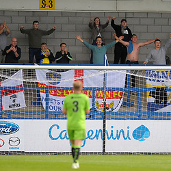 TELFORD COPYRIGHT MIKE SHERIDAN King Lynn fans celebrate their win at full time during the National League North fixture between AFC Telford United and Kings Lynn Town at the Bucks Head on Tuesday, August 13, 2019<br /> <br /> Picture credit: Mike Sheridan<br /> <br /> MS201920-009