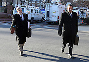 CHARLOTTESVILLE, VA - FEBRUARY 13: Commonwealth attorneys Dave Chapman, left, and Claude V. Worrell, II, right, walk to the Charlottesville Circuit courthouse for the George Huguely trial. Huguely was charged in the May 2010 death of his girlfriend Yeardley Love. She was a member of the Virginia women's lacrosse team. Huguely pleaded not guilty to first-degree murder. (Credit Image: © Andrew Shurtleff