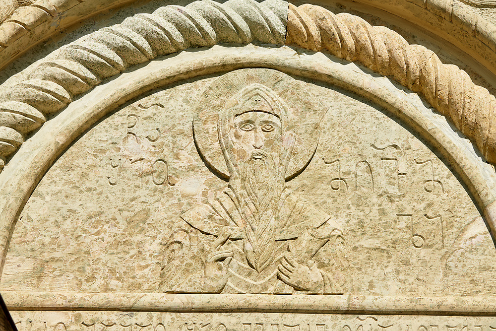 Pictures and images of bas relief sculpture of the chapel in the historic medieval Kintsvisi Monastery Georgian Orthodox Monastery complex, Shida Kartli Region, Georgia (country).<br /> <br /> Kintsvisi Monastery is the best preserved example of Georgian architecture of the 12th and 15th centuries, the so called Georgian Golden Age. .<br /> <br /> Visit our MEDIEVAL PHOTO COLLECTIONS for more   photos  to download or buy as prints https://funkystock.photoshelter.com/gallery-collection/Medieval-Middle-Ages-Historic-Places-Arcaeological-Sites-Pictures-Images-of/C0000B5ZA54_WD0s<br /> <br /> Visit our REPUBLIC of GEORGIA HISTORIC PLACES PHOTO COLLECTIONS for more photos to browse, download or buy as wall art prints https://funkystock.photoshelter.com/gallery-collection/Pictures-Images-of-Georgia-Country-Historic-Landmark-Places-Museum-Antiquities/C0000c1oD9eVkh9c