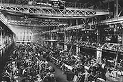 World War I 1914-1918:  Cannon workshop, Krupp works, Essen, Ruhr, Germany, 1917.  Machine shop with overhead cranes and power transmission by belt and shafting. Factory, Tools, Armaments, Weapon, Gun
