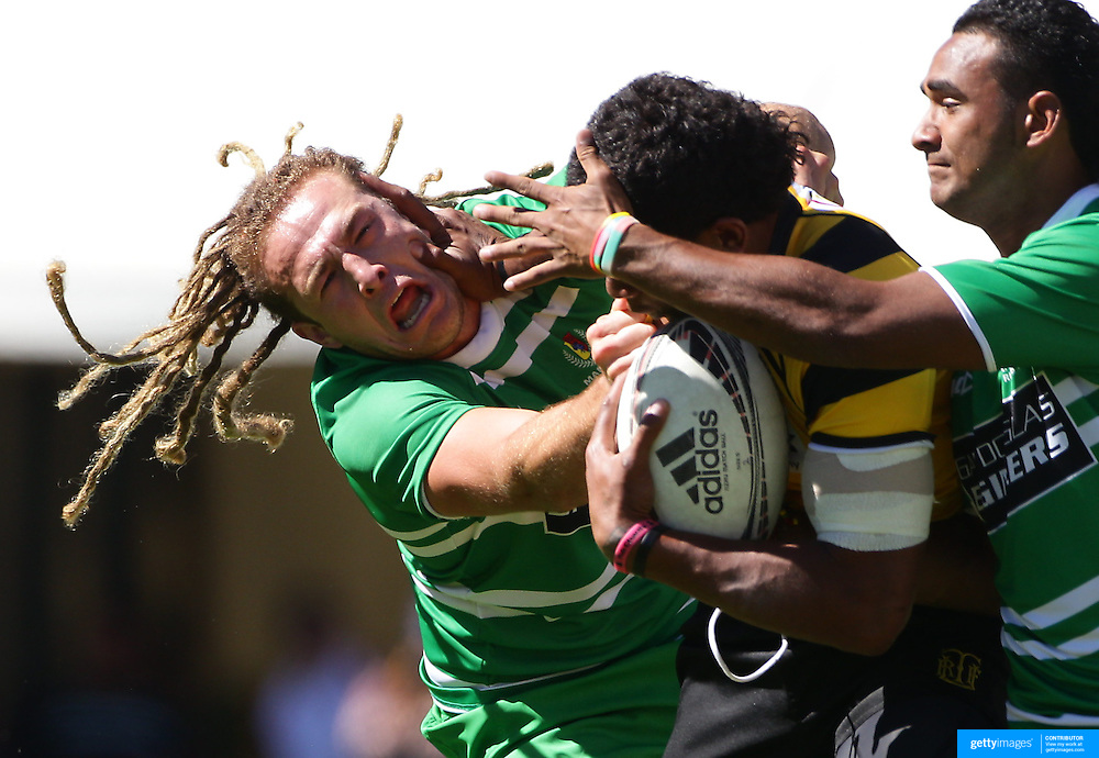 Sam Aupouri, Manawatu  is fended off by Seta Tamanivula of Taranaki during the Pub Charity Rugby Sevens 2012 New Zealand tournament at the Queenstown Recreation Ground, Queenstown, Otago, New Zealand. 8th January 2012. Photo Tim Clayton