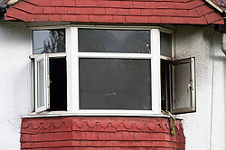 © Licensed to London News Pictures. 28/05/2019.<br /> Orpington,UK. Upstairs front bedroom window. A woman has died at the scene of a house fire over night in Orpington, South East London, 25 firefighters were called to the fire at around 11pm. The cause of the fire is being investigated by Met police and London Fire Brigade. Photo credit: Grant Falvey/LNP