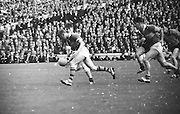 Kerry forward runs with ball toward Down goalmouth as Down approaches from the side during the All Ireland Senior Gaelic Football Final Kerry v Down in Croke Park on the 22nd September 1968. Down 2-12 Kerry 1-13.