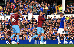 West Ham United's Andriy Yarmolenko (centre) celebrates scoring his side's first goal of the game during the Premier League match at Goodison Park, Liverpool.