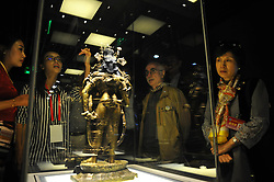 LHASA, Sept. 12, 2016 (Xinhua) -- Visitors watch a Buddha statue displayed at an exhibition in the Potala Palace in Lhasa, capital of southwest China's Tibet Autonomous Region, Sept. 12, 2016. An exhibition of 105 cultural relics selected from the collection of the Potala Palace started on Monday here.  (Xinhua/Jigme Dorje) (zhs) (Credit Image: © Jigme Dorje/Xinhua via ZUMA Wire)