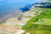 Nederland, Friesland, Gemeente Ferweradeel, 05-08-2014; <br /> Noorderleeg (Noarderleech) ook Noard-Fryslan Butendyks , buitendijkse polder en kweldergebied grenzend aan het Friesche Wad. Landaanwinning door middel van zogenaamde  kwelderwerken: vakken begrenst door rijshouten golfbrekers die als gevolg hebben dat het slib kan bezinken. Als de kwelders hoog genoeg groeien er er kwelderplanten.<br /> Land reclamation, Noorderleeg (Northern Void), polder and salt marsh area outside the dikes. The so-called salt marsh works consist of square sections, bordered by brushwood breakwaters causing the sludge to settle.<br /> luchtfoto (toeslag); aerial photo (additional fee required); foto Siebe Swart / photo Siebe Swart