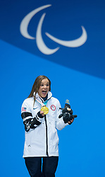 March 17, 2018 - Pyeongchang, South Korea - Oksana Masters of the US celebrates with her newest gold medal during a Medal Ceremony for the 5km Cross Country event Saturday, March 17, 2018 at the Pyeongchang Medals Plaza at the Pyeongchang Winter Paralympic Games. Photo by Mark Reis (Credit Image: © Mark Reis via ZUMA Wire)