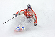"""SHOT 12/6/2007 - A skiier plows through some fresh powder at Crested Butte Mountain Resort one afternoon. Images of dining, shopping and places to stay in the town of Crested Butte, Co. A former coal mining town now called """"the last great Colorado ski town"""", Crested Butte is a popular destination for skiing, mountain biking, and a variety of other outdoor activities. The town also features Elk Avenue, an historic main street where much of the shopping and dining is located. The primary winter activity in Crested Butte is skiing or snowboarding at nearby Crested Butte Mountain Resort in Mount Crested Butte, Colorado.(Photo by Marc Piscotty/ © 2007)"""